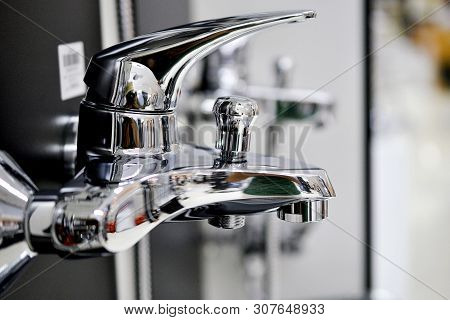 Water Faucet, Bathroom Faucet And Kitchen Faucet. Chrome-plated Metal. Shallow Dof.pictured In A Sho