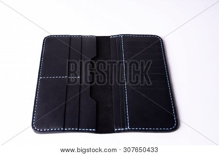 Two Handmade Black Leather Porte-monnaie Isolated On White Background. Stock Photo Of Luxury Accesso