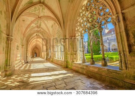 Batalha, Portugal - August 16, 2017: Beautiful Corridor, Arches And Manueline Colonnade Of Royal Clo