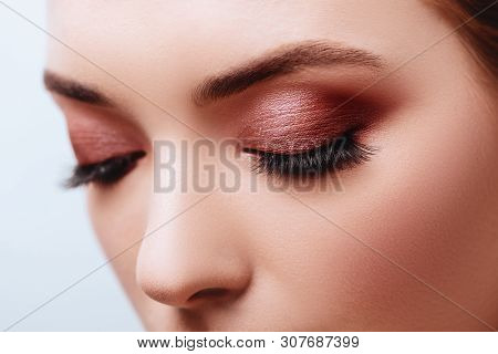 Close Up View Of Blue Woman Eye With Beautiful Golden Shades And Black Eyeliner Makeup. Classic Make