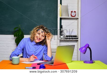 Back to school. Portrait of smiling teacher in classroom. Learning and education concept. Student and tutoring education concept. Smiling teacher in glasses. Homework. poster