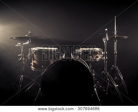 Drum Set On A Stage At Dark Background. Musical Drums Kit On Stage.