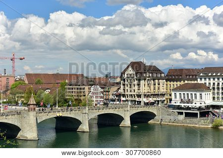Basel, Switzerland - April 17, 2019. Rhine River On A Spring Sunny Day. View Of The Middle Bridge. C