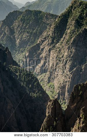 The Gunnison River Cuts Through Jagged Cliffs To Form Black Canyon Of The Gunnison