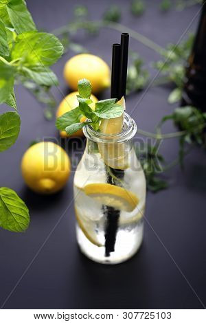 Water With Lemon, Water In A Glass Bottle With Lemon And Mint.