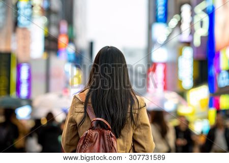 Young Asian Woman Traveler Traveling And Shopping In Myeongdong Street Market At Seoul, South Korea.
