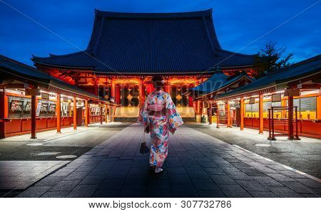 Japanese Lady In Kimono Dress Walking In Sensoji Temple, Asakusa City, Tokyo, Japan. This Image Can