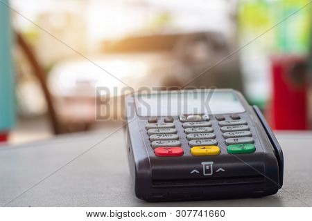 Credit Card Machine With Car Refueling Petrol At Gasoline Station In Background. Credit Card Reader