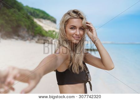 Follow Me Concept. Charming Romantic Tanned Bloned Girlfriend Give Boyfriend Hand Turn Back Smiling