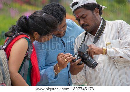 Bangalore, Karnataka India-june 04 2019 :indian Photographer Showing Photos To Clients On Photo Came