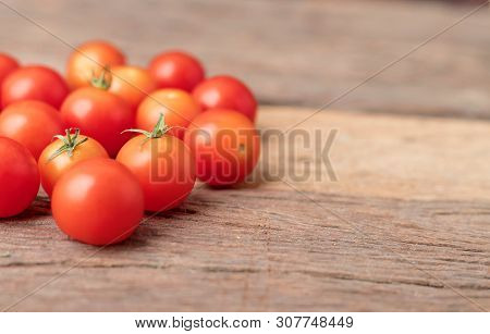 Group Red Tomatoes On The Wooden Table. Cherry Tomato Is A Small That Has A Sweet, Firm Texture And