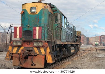 The old Soviet shunting locomotive. Standing on the switches. poster