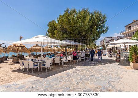 Mallorca, Spain - May 6, 2019: Seaside Promenade In Port De Pollenca (puerto Pollensa), A Popular Fa