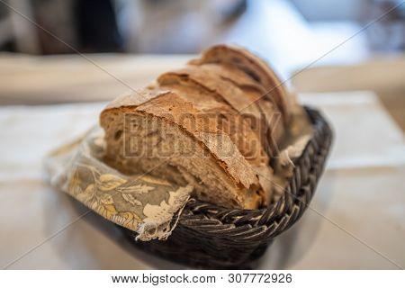 Homemade Bread Cut Into Slices In A Wicker Basket.