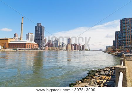 East River Landscape With Manhattan On The Left And Roosevelt Island Apartments Complex On The Right