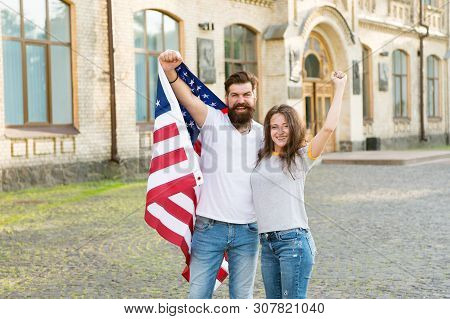 American Citizenship Is A Very Precious Possession. Bearded Man And Sensual Woman Holding American F