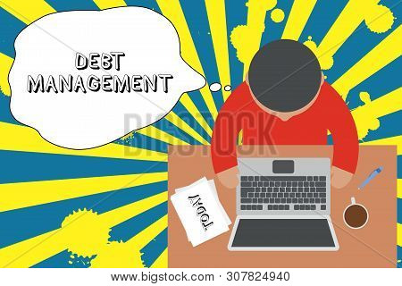 Writing note showing Debt Management. Business photo showcasing The formal agreement between a debtor and a creditor Upper view young man sitting table laptop documents coffee cup pen. poster