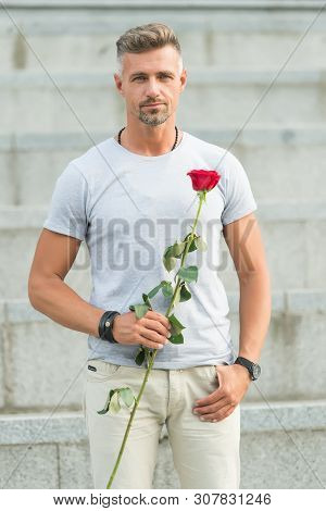 Life is too short to live without love. Man mature well groomed macho wait for his darling. Handsome guy with rose flower romantic date. Man in love romantic mood. Surprise for his love. Love concept. poster