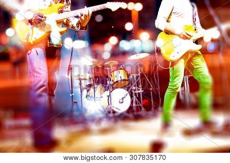 Live Music Background And Music Band On Stage. Live Music And Rock Band On Stage