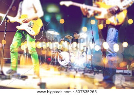 Abstract Musical Background. Playing Guitar And Music Concert Concept. Live Music And Rock Band On S