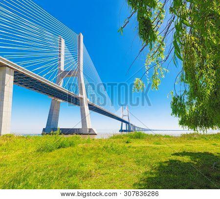Modern Bridge And Architecture With Nature And Blue Sky.vasco Da Gama Bridge In Lisbon,portugal.