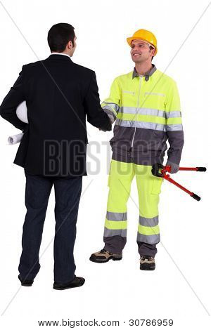 Architect and construction worker shaking hands