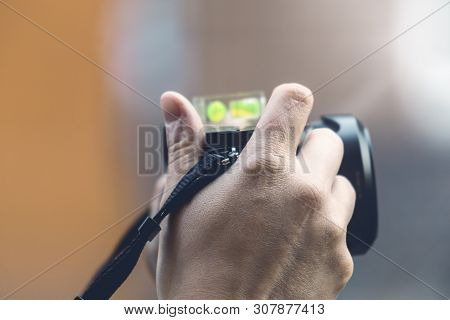 Close Up Of A Hand Holding A Camera