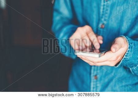 Man Typing Phone Message On Social Network