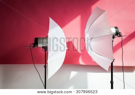 Photography Studio Flash Strobe For Light And Picture Taking On Pink Color. Tools For Professional P