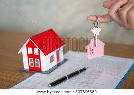 Your New House, Real Estate Agent Holding House Key To His Client After Signing Contract Agreement I
