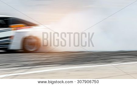Sport Car Wheel Drifting. Blurred Of Image Diffusion Race Drift Car With Lots Of Smoke From Burning