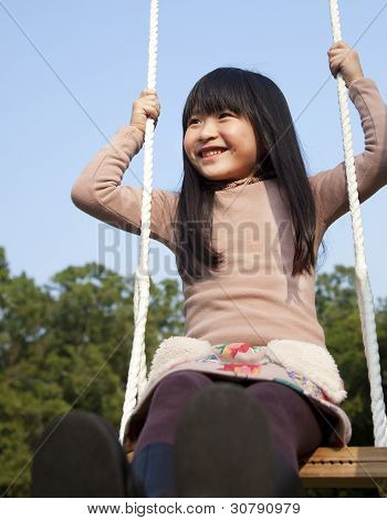 Happy Girl On The Swing