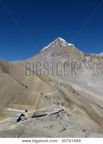 Thorung Phedi high camp, mountain named Yakwakang. Trekking trail to the Thorung la pass, 5400 m altitude. poster