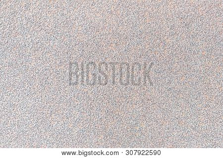 Texture of white extra coarse aluminum oxide sandpaper. Abrasive paper for dry sanding. Processing wood, metals and furniture. Background. Top view. poster