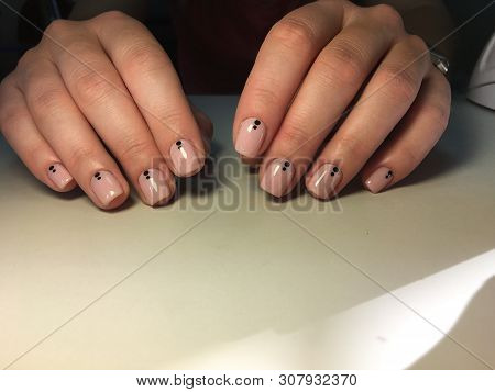 Fashionable Light Manicure And Points On Short Nudity
