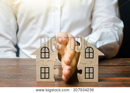 A Lawyer Shares A House Or Property Between Owners. Divorce Concept. The Division Process Of Real Es