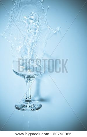 Drinking Glass Spilling Over And Splashing Clear Liquid