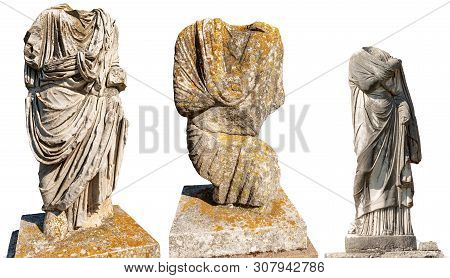 Three Marble Roman Statues With Toga Without Head Isolated On White Background. Ostia Antica, Colony