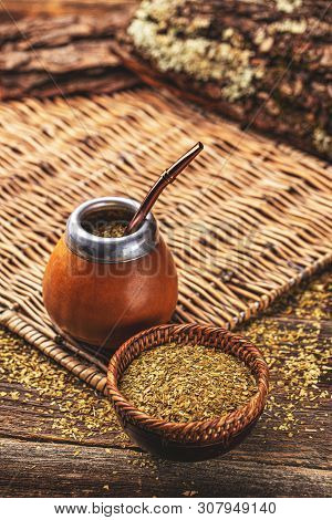 Composition Of Yerba Mate South American Tea, Dried Leaves In Wooden Bowl And Mate Calabash With Bom