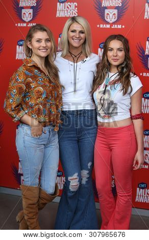 NASHVILLE, TN - JUN 3: (L-R) Hannah Mulholland, Jennifer Wayne and Naomi Cooke of Runaway June attend CMT's RAMJAM at TopGolf on June 3, 2019 in Nashville, Tennessee.