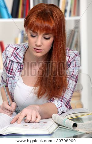 Young woman studying for an exam