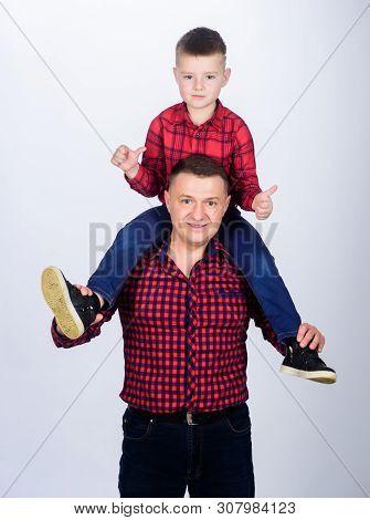 Father example of noble human. Father little son red shirts family look outfit. Best friends forever. Dad piggybacking adorable child. Having fun. Happiness being father of boy. Fathers day poster