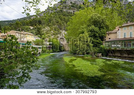South Of France, View On Small Touristic Provencal Town Of Poet Petrarch Fontaine-de-vaucluse With E