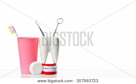 Dental Health And Teethcare Concept. Dental Mirror And Dental Explorer Instrument In White Tooth Mod