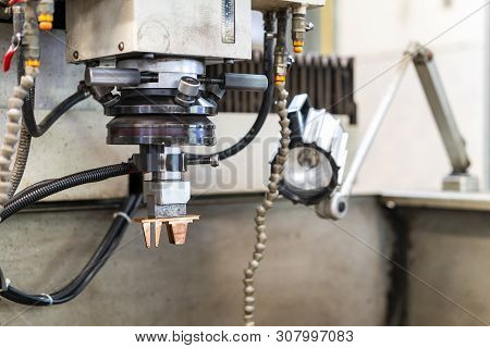 close up copper electrode during setup on automatic electrical discharge machine (edm) or spark machining poster