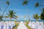 wedding setup,  arch,  decorated with flowers, beach wedding setup poster