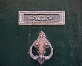 An old style decorative bronze door handle on a wooden door, the distinctive feature and symbol of Malta in Mdina. poster