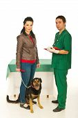 Owner woman with dog visit veterinary man in his office poster