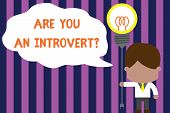 Text sign showing Are You An Introvertquestion. Conceptual photo demonstrating who tends to turn inward mentally Standing man tie holding plug socket light bulb to connect idea. Startup. poster