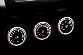 Black Detail With The Air Conditioning Button, Inside A Car. Close Up Car Ventilation System And Air
